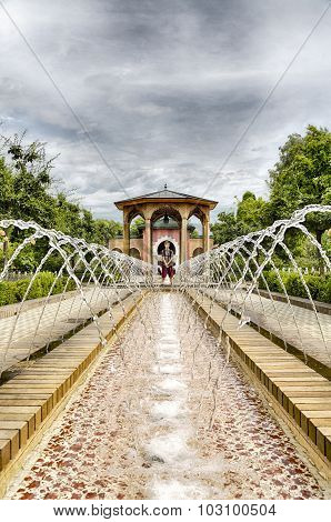 Hdr Shot Of A Teenage Boy Standing At A Fountain