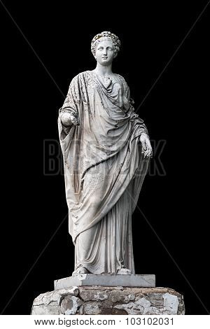 Marble statue of roman Ceres or greek Demeter isolated on black from the park of the Palace and park complex Estate of G. Galagan. Sokyryntsi village Ukraine