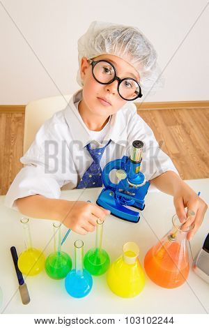 A boy concentrated working in the laboratory. Science and education. School.