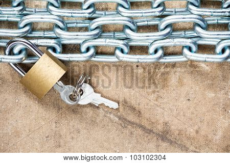 Padlock And Chain On The Dirty Background