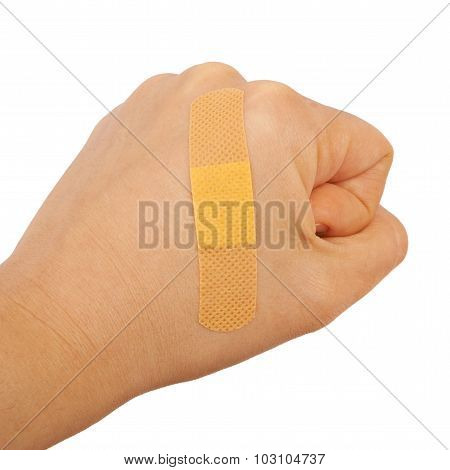 On a man's hand fist glued medical plaster first