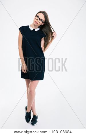 Full length portrait of a pretty woman in dress and glasses posing isolated on a white background