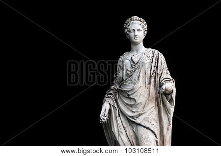 Marble statue of roman Ceres or greek Demeter isolated on black from the park of the Palace and park complex Estate of G. Galagan. Sokyryntsi village Ukraine. Horizontal reflection of the original