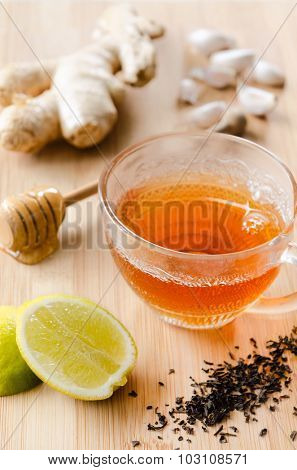 Cup of tea with ginger, lemon, honey, garlic for soothing detox drink