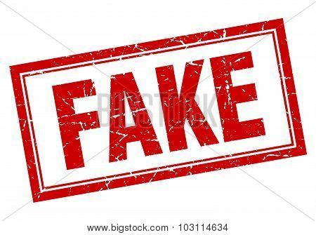 Fake Red Square Grunge Stamp On White