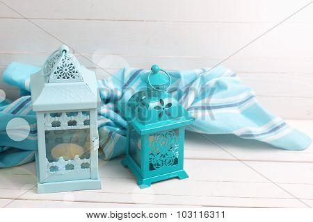 Decorative Lanterns  And Blue Towel