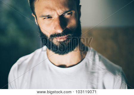 Portrait of a bearded man wearing white tshirt on the blure background