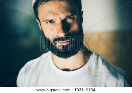 Portrait of a bearded man wearing white tshirt