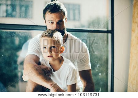 Portrait of a bearded man and his son