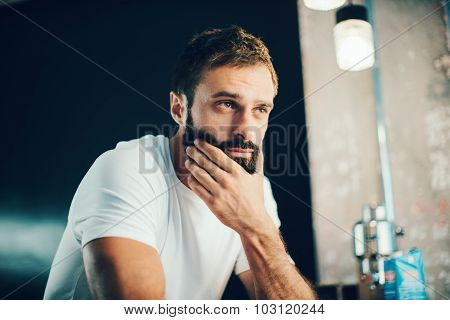 Mockup of a bearded man wearing white tshirt and looking something