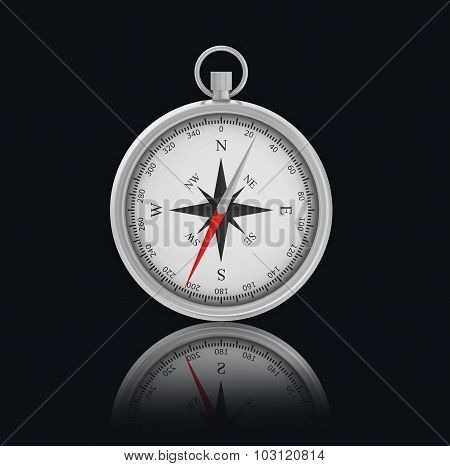Chrome Compass on black background with reflection