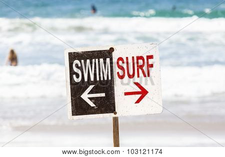 Swim And Surf Sign On The Beach, California, Usa.