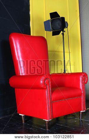 Red Big Armchair With Studio Light