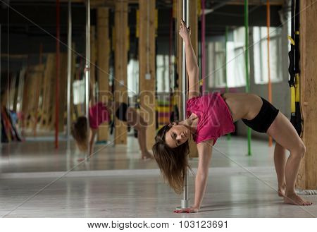 Girl Bending By The Pole