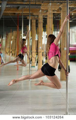 Pole Dancer In Acrobatic Pose