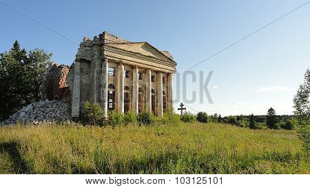 Old russian christian orthodox church ruins in the middle of the field