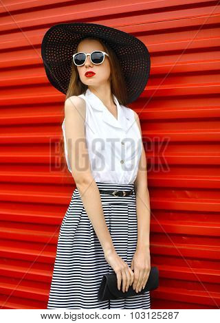 Fashion Portrait Of Beautiful Woman Wearing A Sunglasses, Straw Hat And Striped Skirt With Handbag C