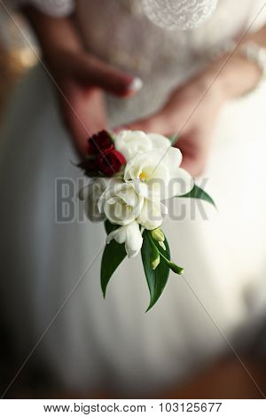 The Bride With Buttonholes In Hands