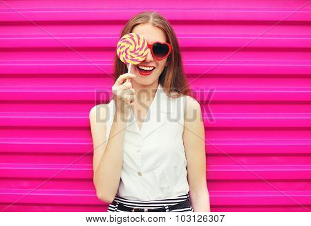 Sweet Pretty Young Woman Having Fun With Lollipop Over Pink Background