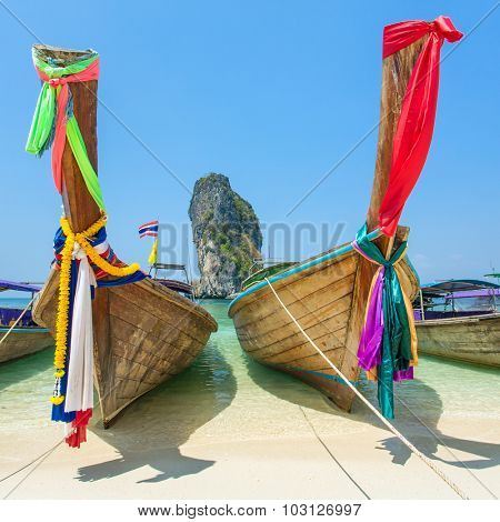Longtail boats at the tropical beach of Poda island in Andaman sea, Thailand