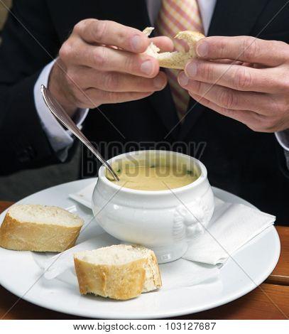 Closeup Of Man Eating A Bowl Of Soup
