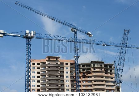 New House And Three Tall Crane