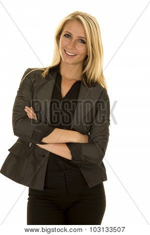 Blond Woman In Black Business Attire Arms Folded