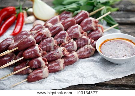 Ready To Cook Duck Heart Stringed On Skewers Bbq With Hot Sauce And Chili Pepper. Decorated With Gre