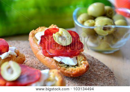 Italian bruschetta bread with salami and mozzarella on a plate