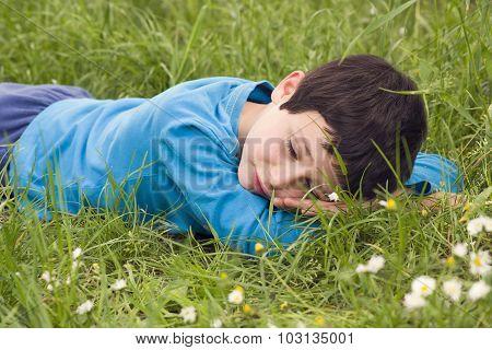 Child Lying In Grass