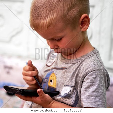 Little Boy With Smartphone