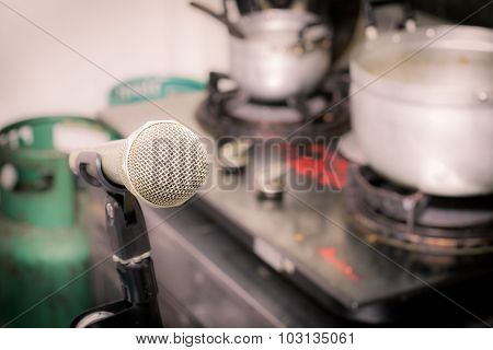 Microphone On The Background Of Blurred Kitchen In Home. Soft Focus .shallow Depth Of Field. Vintage