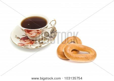 Mug Of Tea And Two Bagels On White