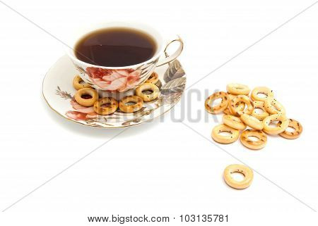 Many Bagels And Cup Of Tea On White