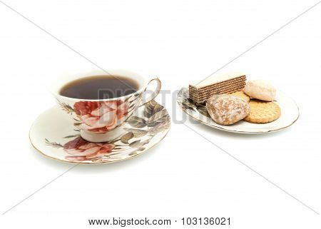 Mug Of Tea And Different Sweets