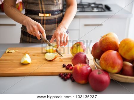 Woman's Elegant Hands Cutting Apples On Board