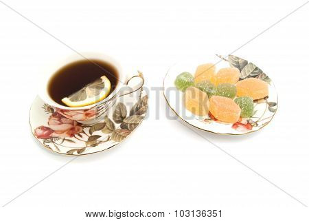 Cup Of Tea With Lemon And Fruit Candy
