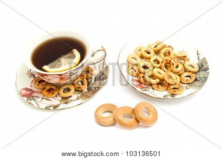 Different Bagels And Cup Of Tea With Lemon