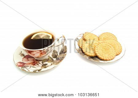 Cup Of Tea With Lemon And Tasty Cookies