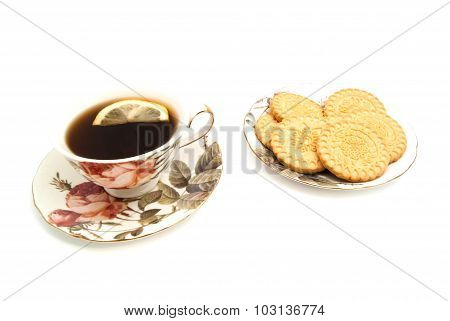 Mug Of Tea With Lemon And Tasty Cookies