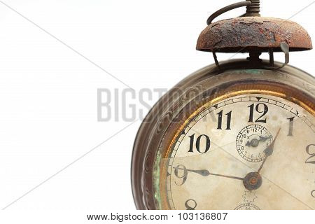 Dial of old alarm clock closeup isolated on white