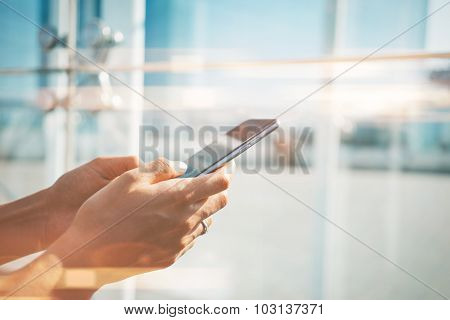 Mock up of girl using her smartphone in the city for send text message