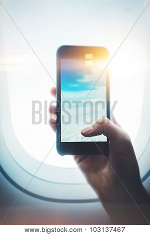 Mock up of girl handing smartphone in hands, private jet
