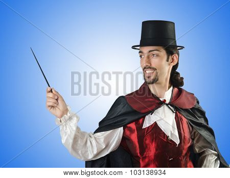 Magician doing tricks on white