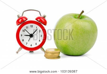 Fresh apple with coins and alarm clock