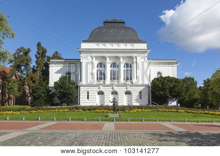 Rendsburg, Germany - September 27, 2015: Frontal view of the Kammerspiele theatre at Rendsburg, opened in 1901. Eva statue by Adolf Bruett in front.