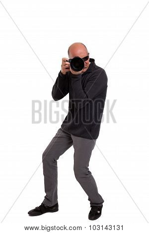 Photographer holding a professional camera
