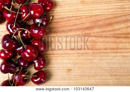 Berry. Cherry on the wooden table