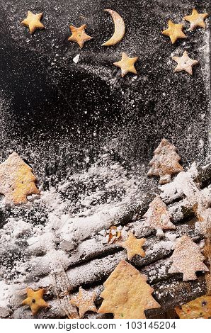 Cookies in the shape of stars and Christmas trees