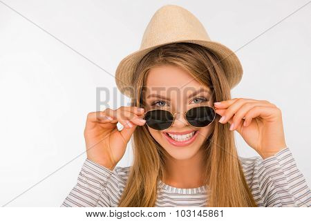 Happy Girl With A Hat Putting Glasses On Her Nose